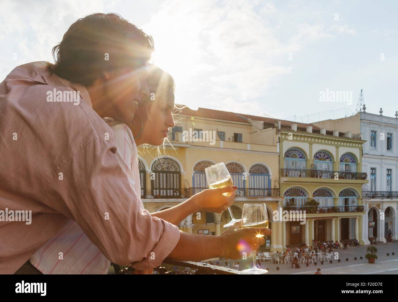 Young couple looking out from restaurant balcony in Plaza Vieja, Havana, Cuba - Stock Image
