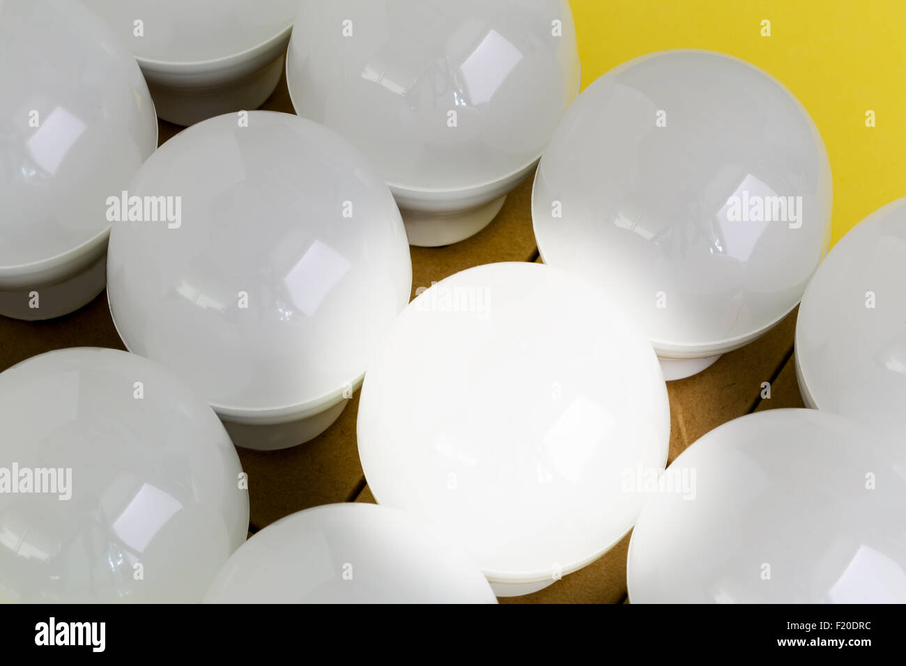 Light bulb illustrating business concept or idea. - Stock Image