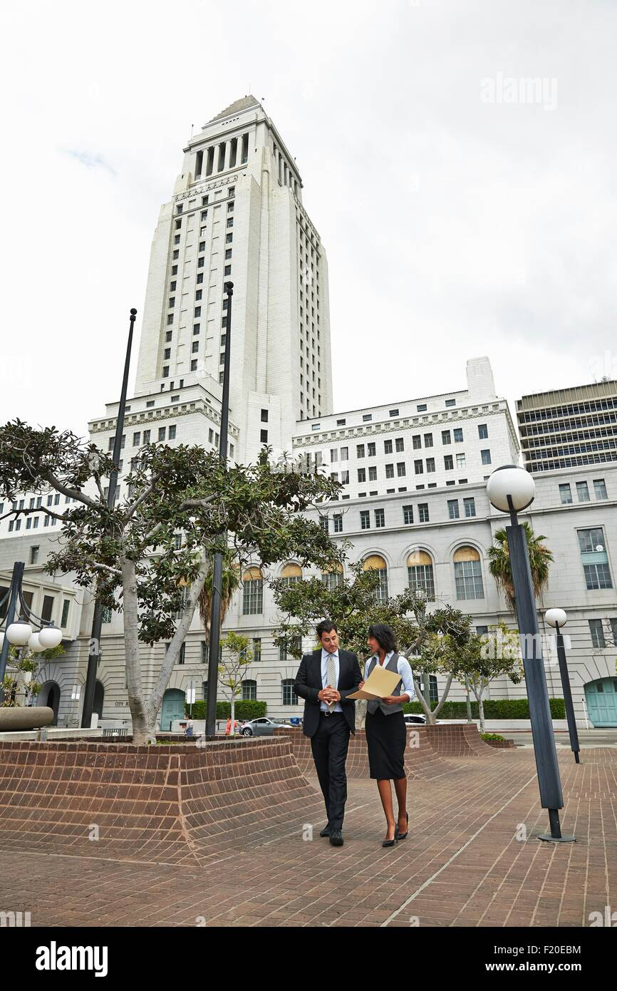 Business people walking across tiled floor, Los Angeles City Hall, California, USA - Stock Image