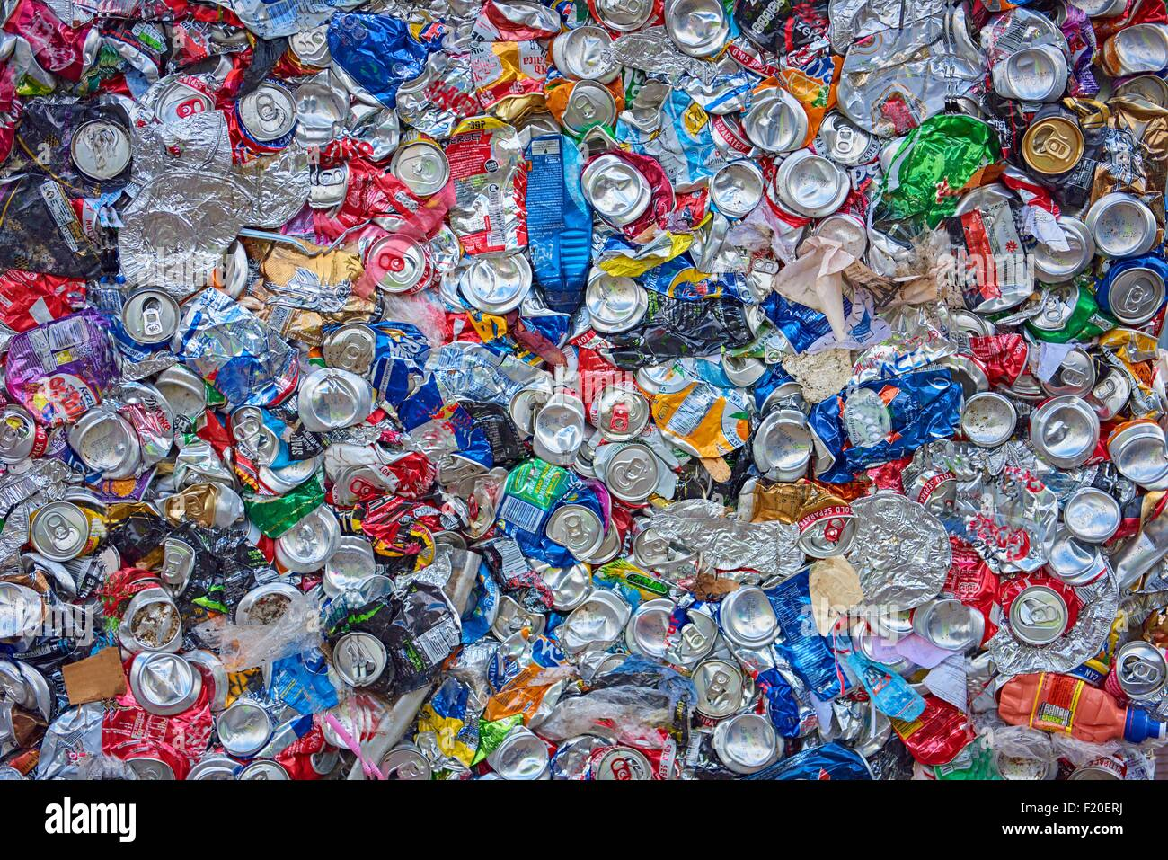 Overhead view of flattened waste aluminium and plastic packaging - Stock Image
