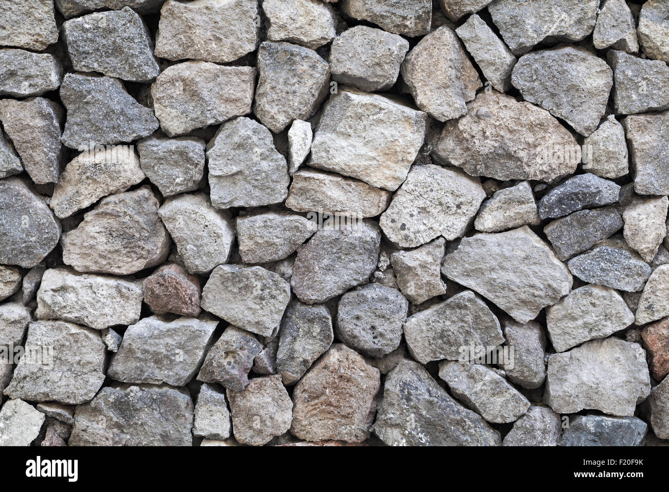 Background texture of gray rough granite stone wall - Stock Image