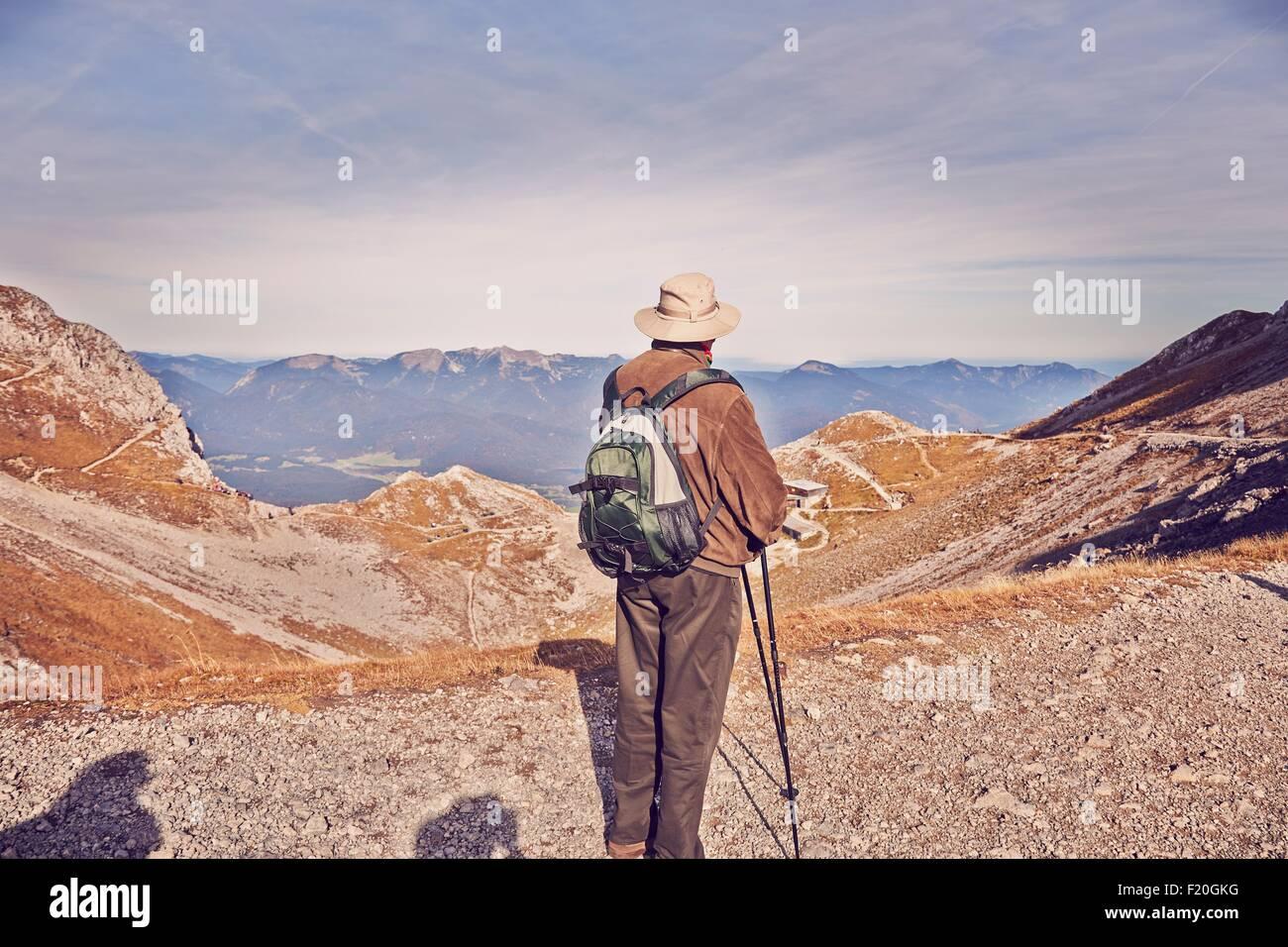 Senior male hiker, looking at view, Karwendel-Mittenwald, Bavaria, Germany - Stock Image