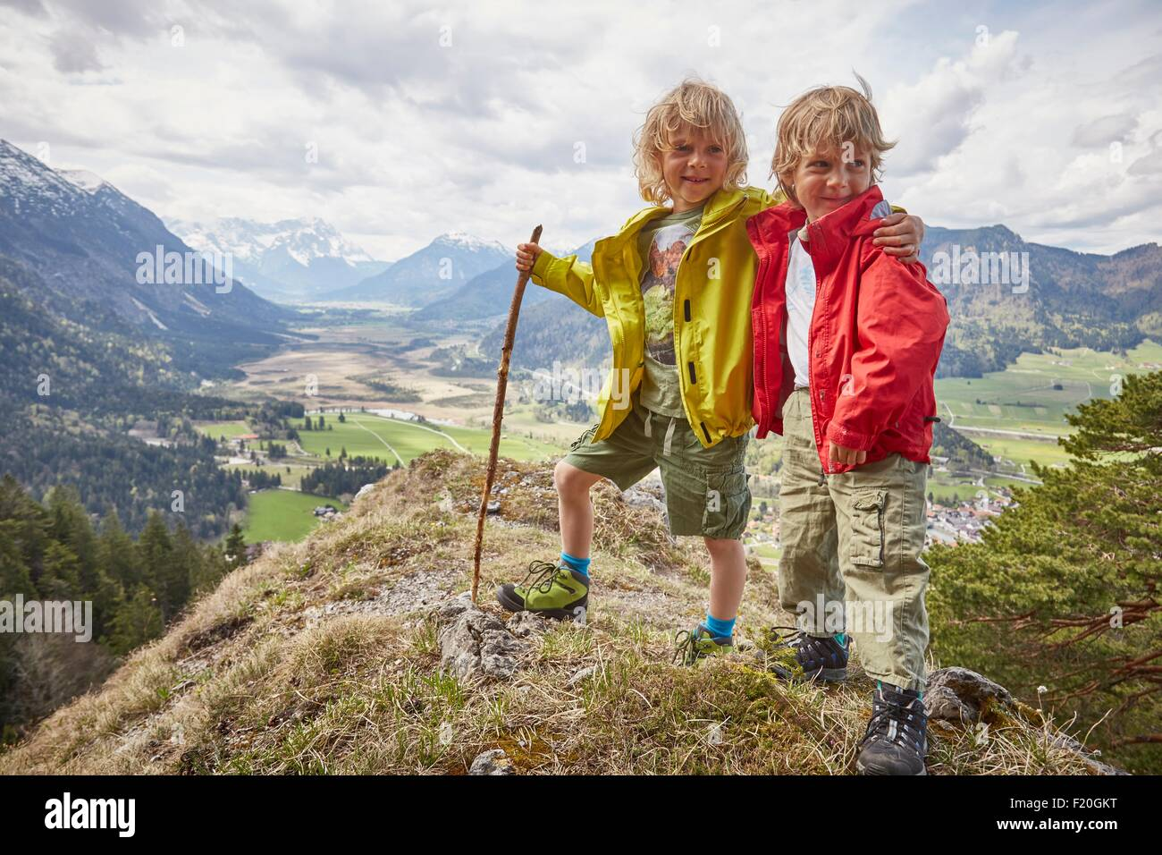 Portrait of two young boys, standing on hilltop, Garmisch-Partenkirchen, Bavaria, Germany Stock Photo