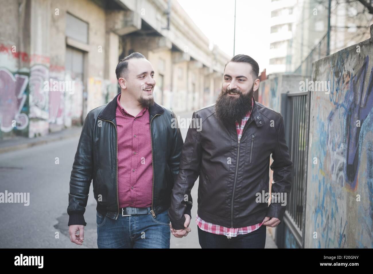 Gay couple walking on street - Stock Image
