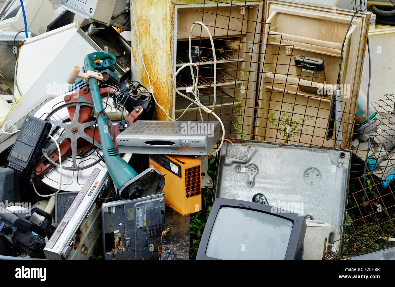pile of discarded electrical junk - Stock Image
