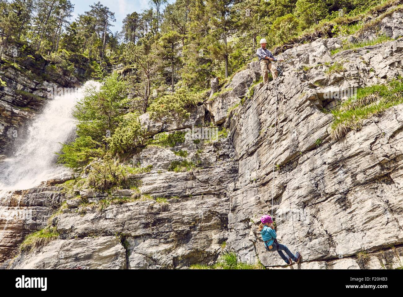 Father and child rock climbing, Ehrwald, Tyrol, Austria Stock Photo