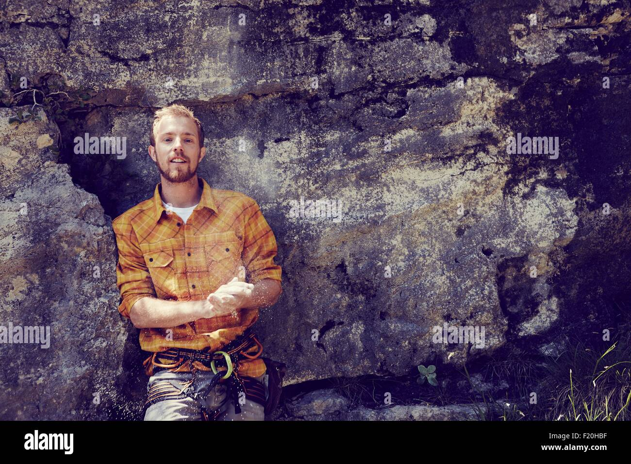 Climber leaning against rock wall, Ehrwald, Tyrol, Austria - Stock Image