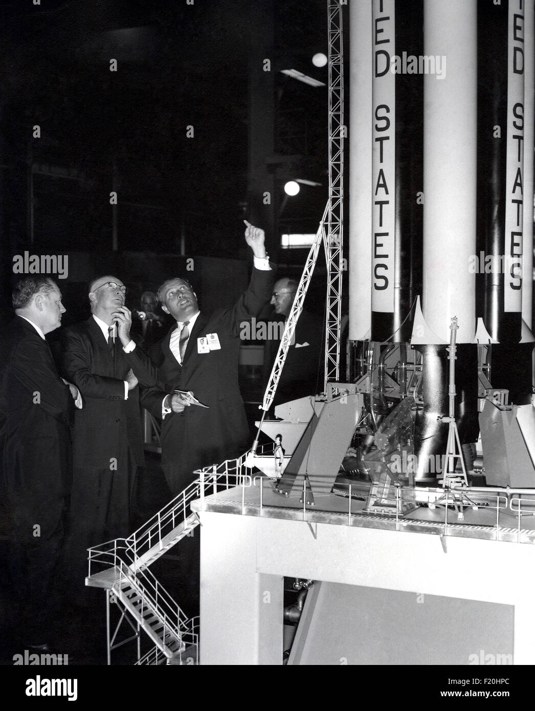 Rocket scientist Wernher von Braun shows U.S. President Dwight Eisenhower (center) a model of the Saturn V rocket - Stock Image
