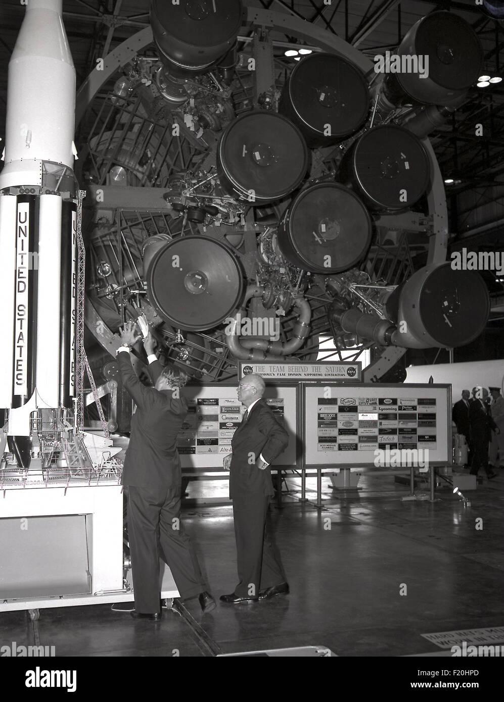 Rocket scientist Wernher von Braun shows U.S. President Dwight Eisenhower a model of the Saturn V rocket during - Stock Image
