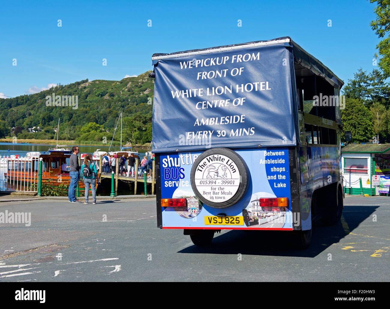 Shuttle bus parked at Waterhead, on Lake Windermere, Lake District National Park, Cumbria, England UK - Stock Image