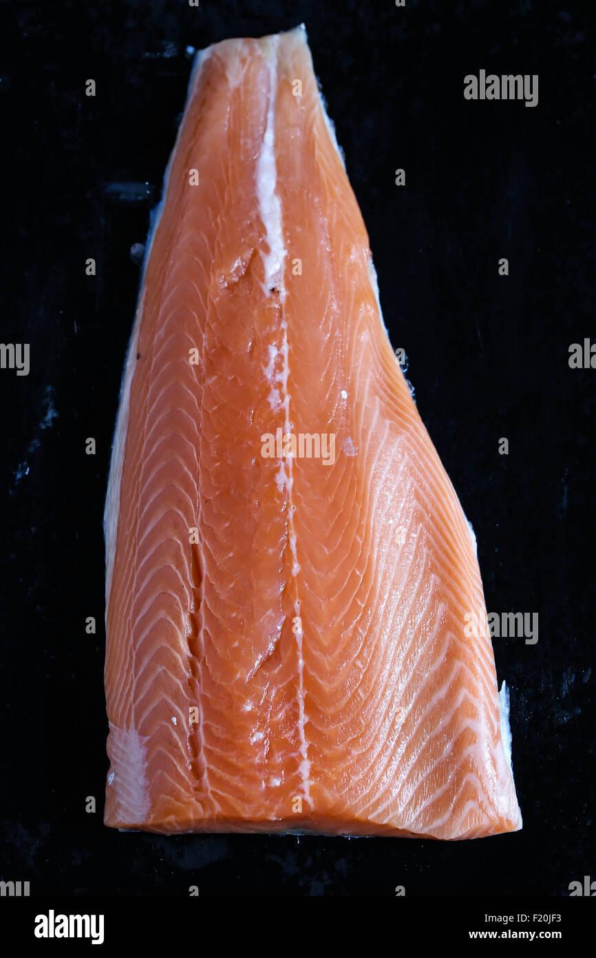 Raw salmon fillet closeup. - Stock Image