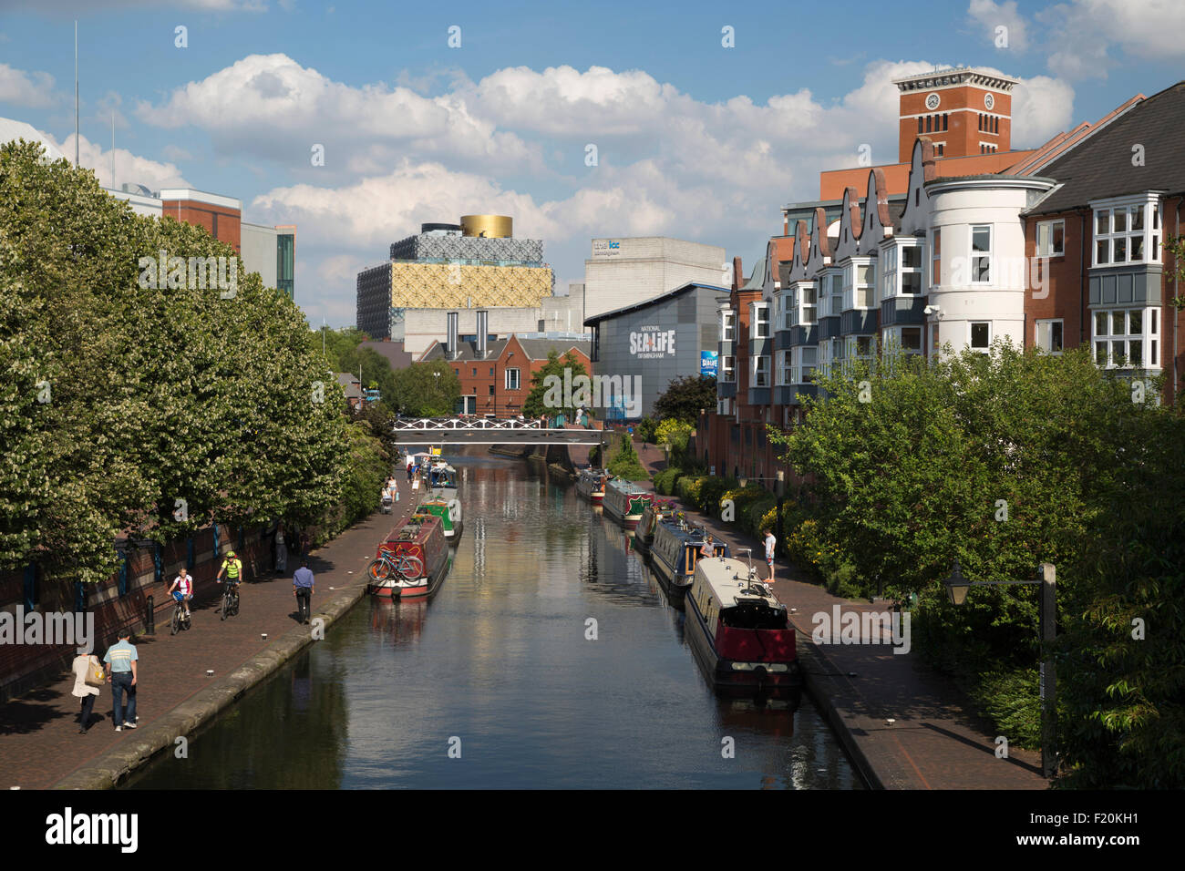 Birmingham Canal lined with apartments and The Library of Birmingham, Birmingham, West Midlands, England, United - Stock Image