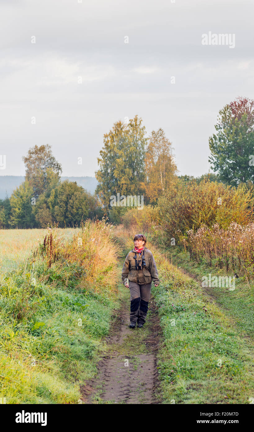 Woman walking in nature Stock Photo