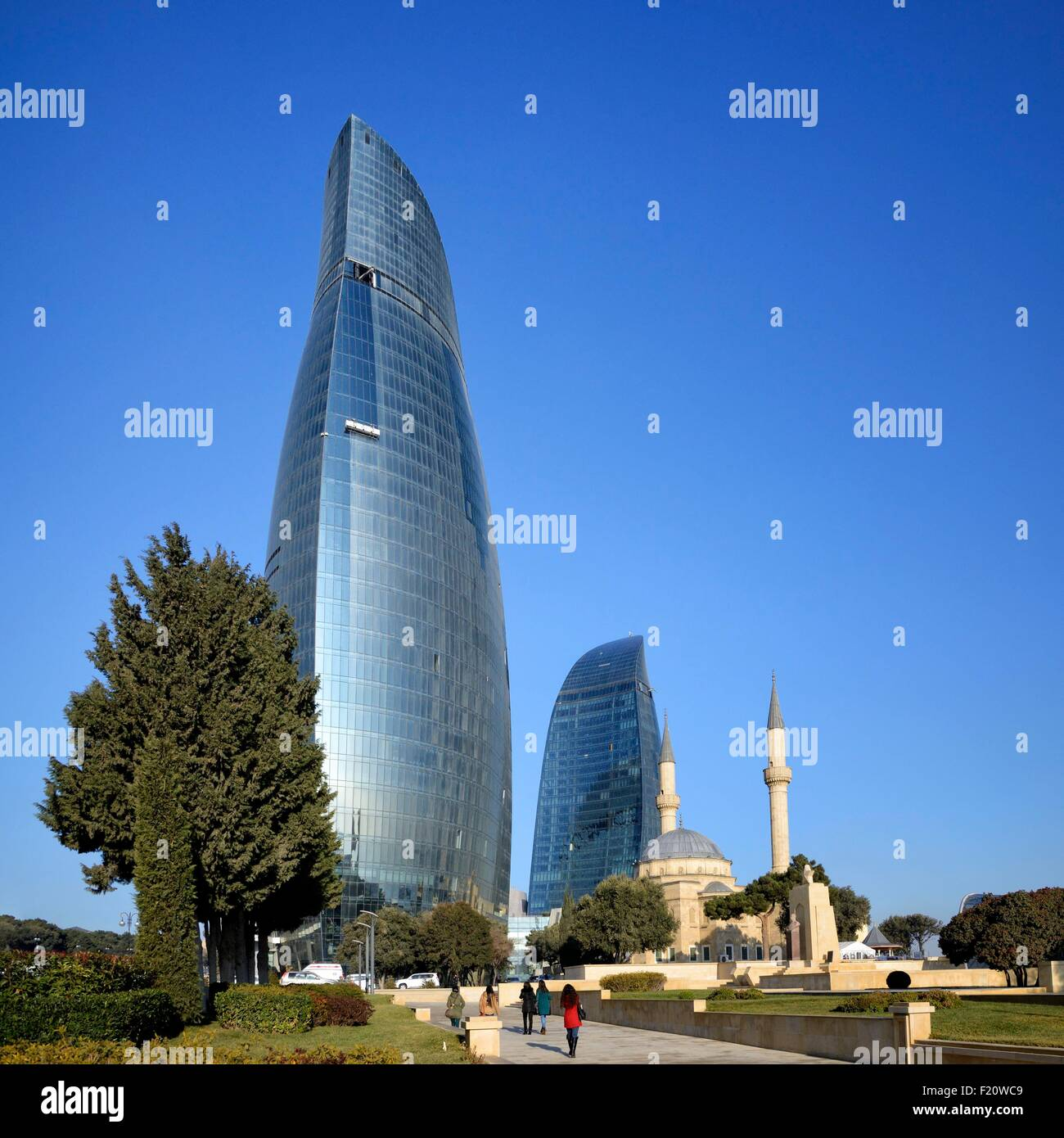 Azerbaijan, Baku, Martyrs' Lane (Alley of Martyrs), small mosque and the Flame Towers Stock Photo