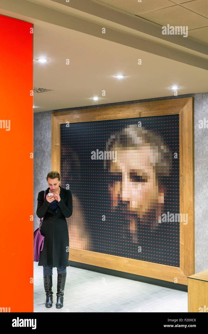 Italy, Lombardy, Milan, Ibis Milano Centro hotel lobby with a work of art representing Giuseppe Verdi - Stock Image
