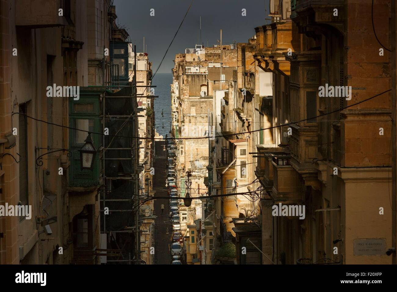 Malta, Valletta, listed as World Heritage by UNESCO,street of the historic city center under a stormy light after - Stock Image