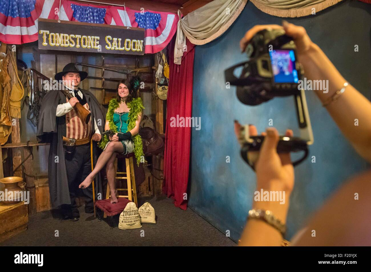 United States, Arizona, Tombstone, historic district, tourists in traditional clothing shooted in a photo studio Stock Photo