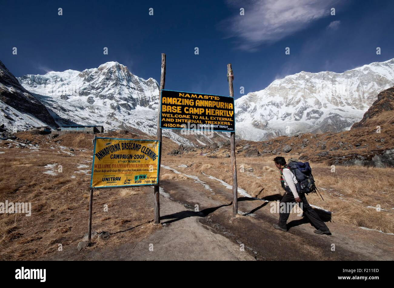 Nepal, Gandaki, Annapurna region, Nepali trekker reaching the Annapurna Base Camp at 4130m altitude - Stock Image