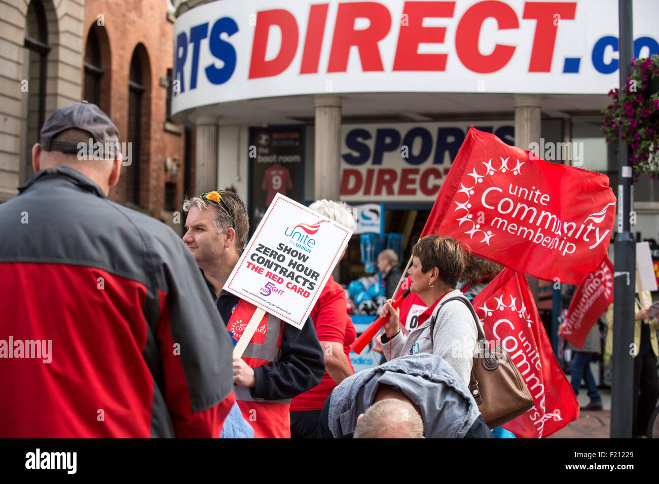 Derby, UK. 09th Sep, 2015. Unite union members, demonstrate outside the shop of Sports Direct in Derby city centre. - Stock Image