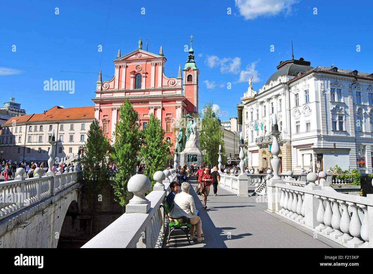 Ljubljana, Slovenia - September 7, 2015 - St. Francis church and triple bridge - Stock Image