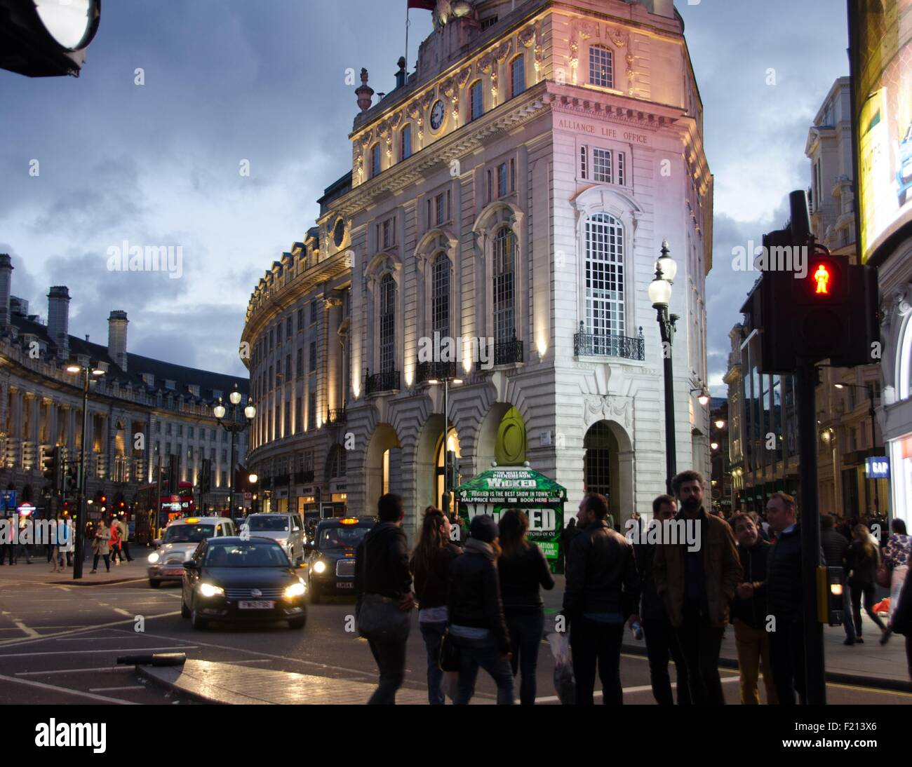 Busy spring evening traffic in Piccadilly Circus, London, UK. - Stock Image