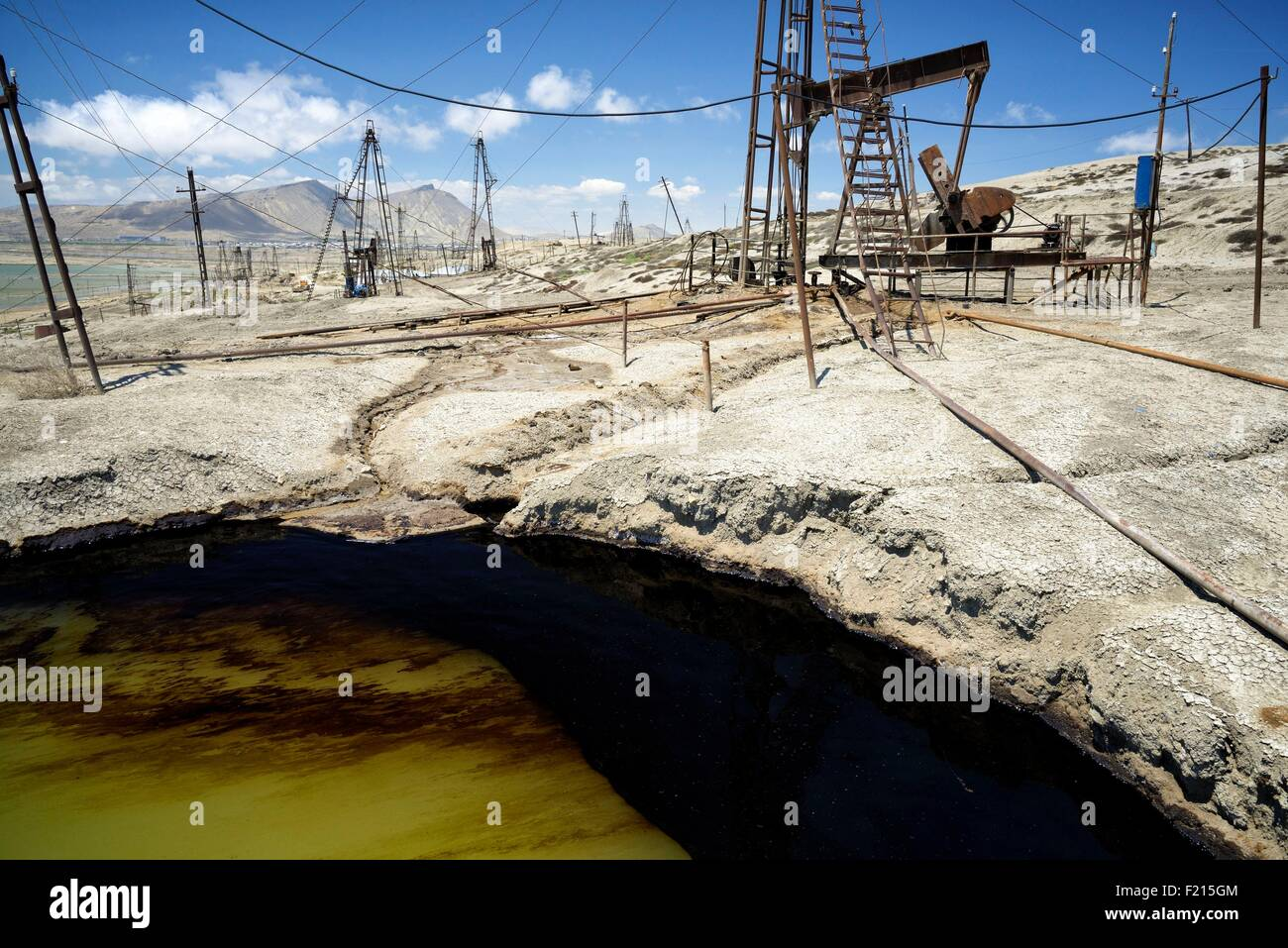 Azerbaijan, Baku, Bibi Heybat, nodding donkey oil pumps pumping oil up from the an oil field - Stock Image