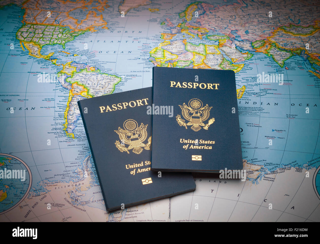 Passports on a world map - Stock Image