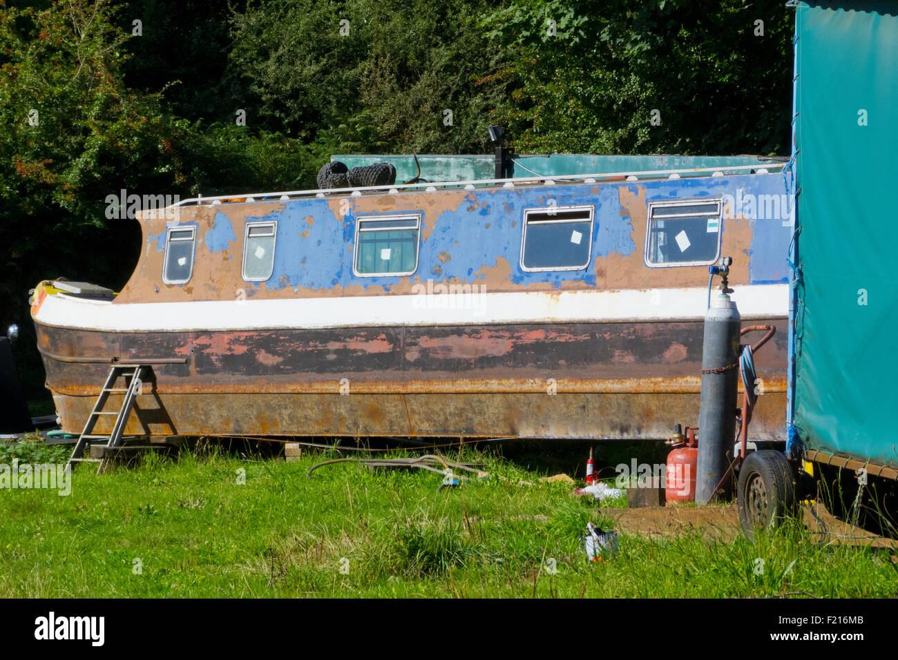 Narrowboat in Dry Dock Undergoing Repair Work, Stourbridge Canal, Staffordshire, England, UK Stock Photo