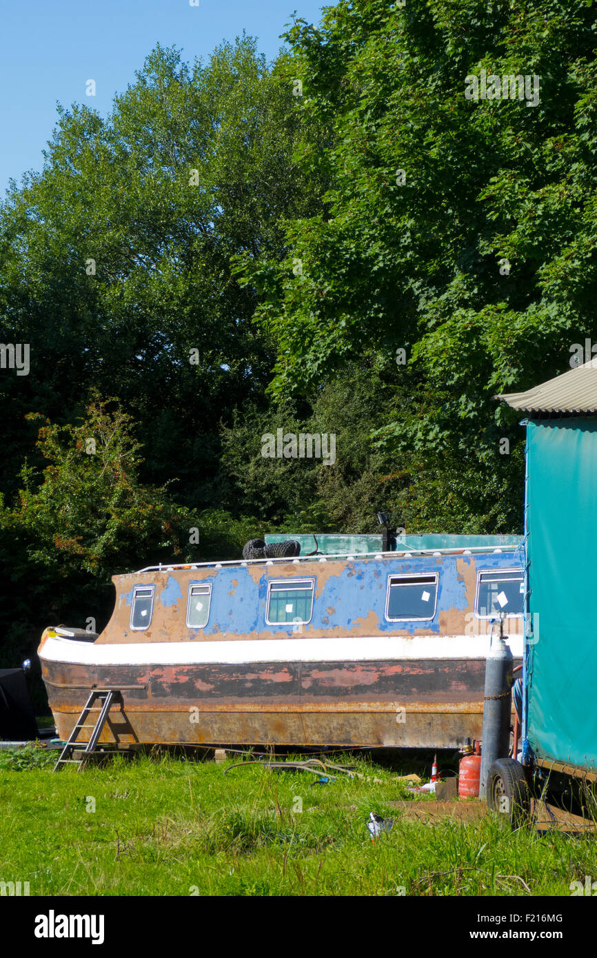 Narrowboat in Dry Dock Undergoing Repair Work, Stourbridge Canal, Staffordshire, England, UK - Stock Image
