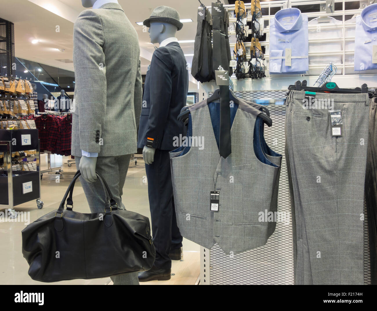 Suits and waistcoats in Primark store. England, UK - Stock Image