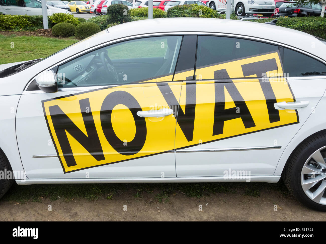 Car outside VW dealership. UK - Stock Image