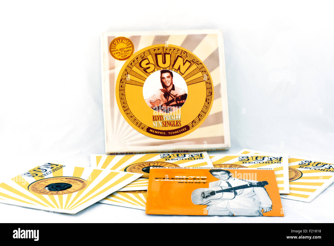 Elvis Presley 7' (seven inch) singles vinyl Sun record reproduction collectors item box set on white background. - Stock Image