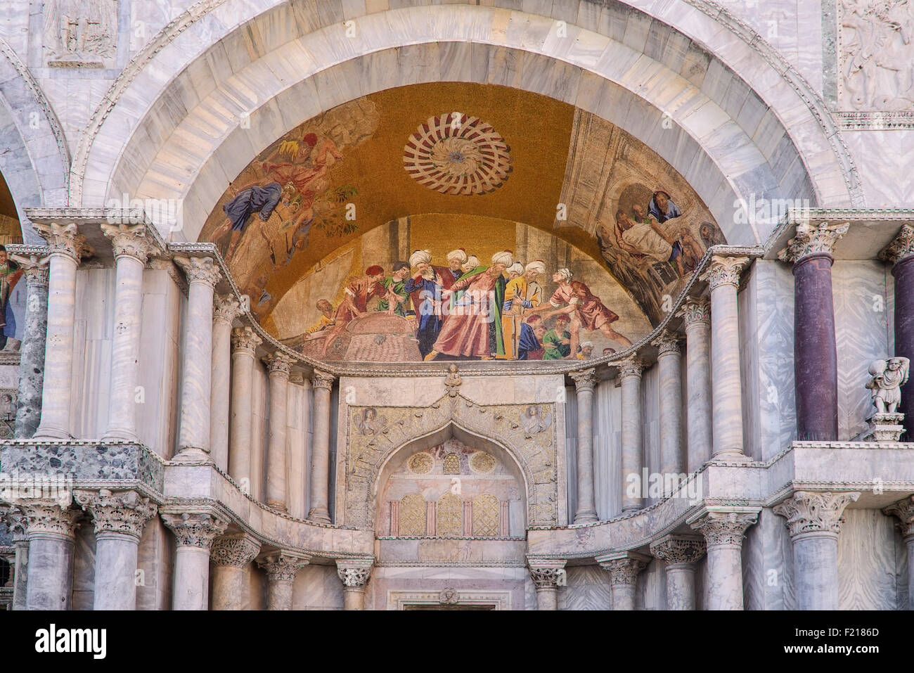 Italy, Venice, St Mark's Basilica, mosaic above a doorway depicting the recovery of St. Mark's body in Alexandria - Stock Image