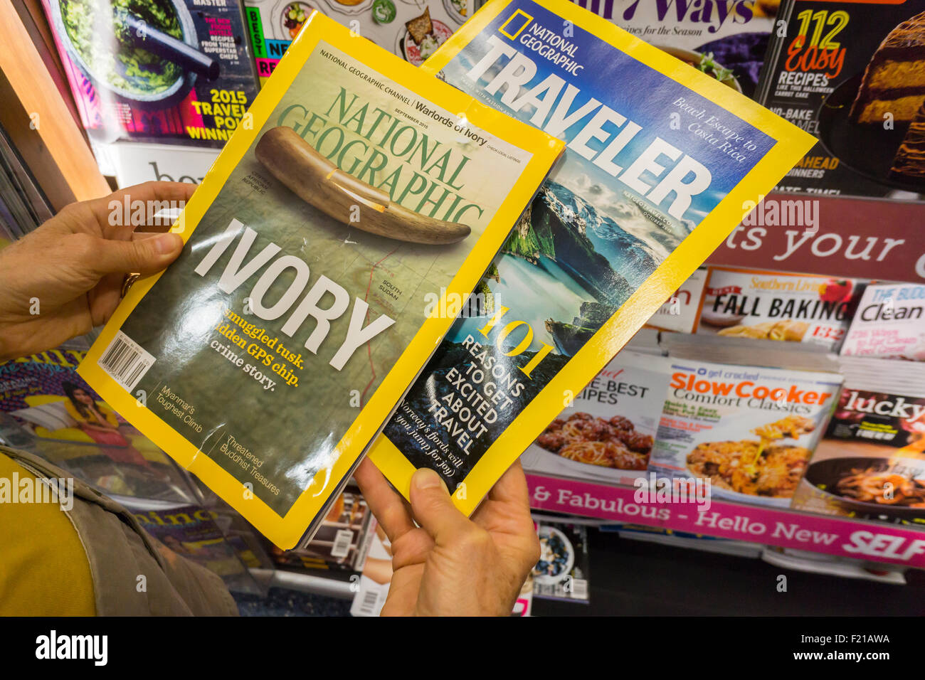 A reader with copies of National Geographic and Nat Geo Traveler at a newsstand in New York on Wednesday, September - Stock Image