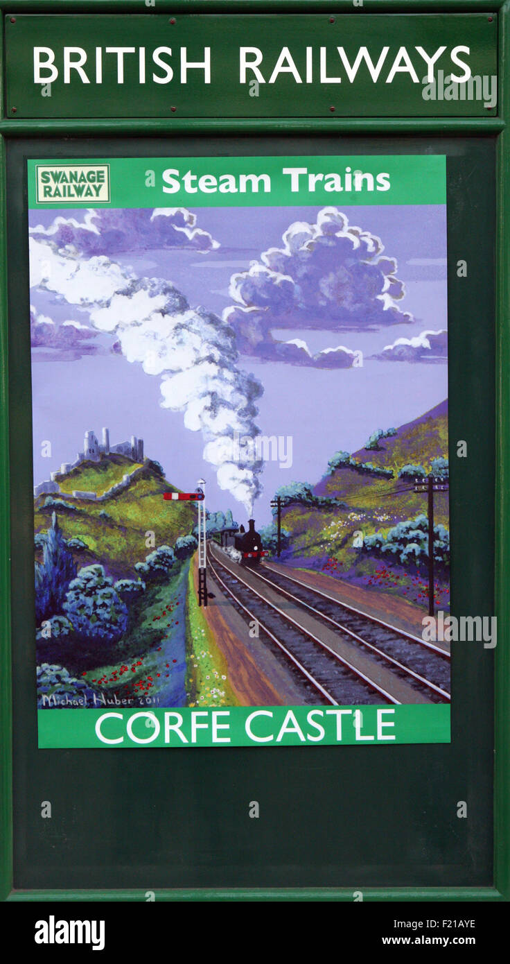 BR poster print of Corfe Castle steam trains - Stock Image
