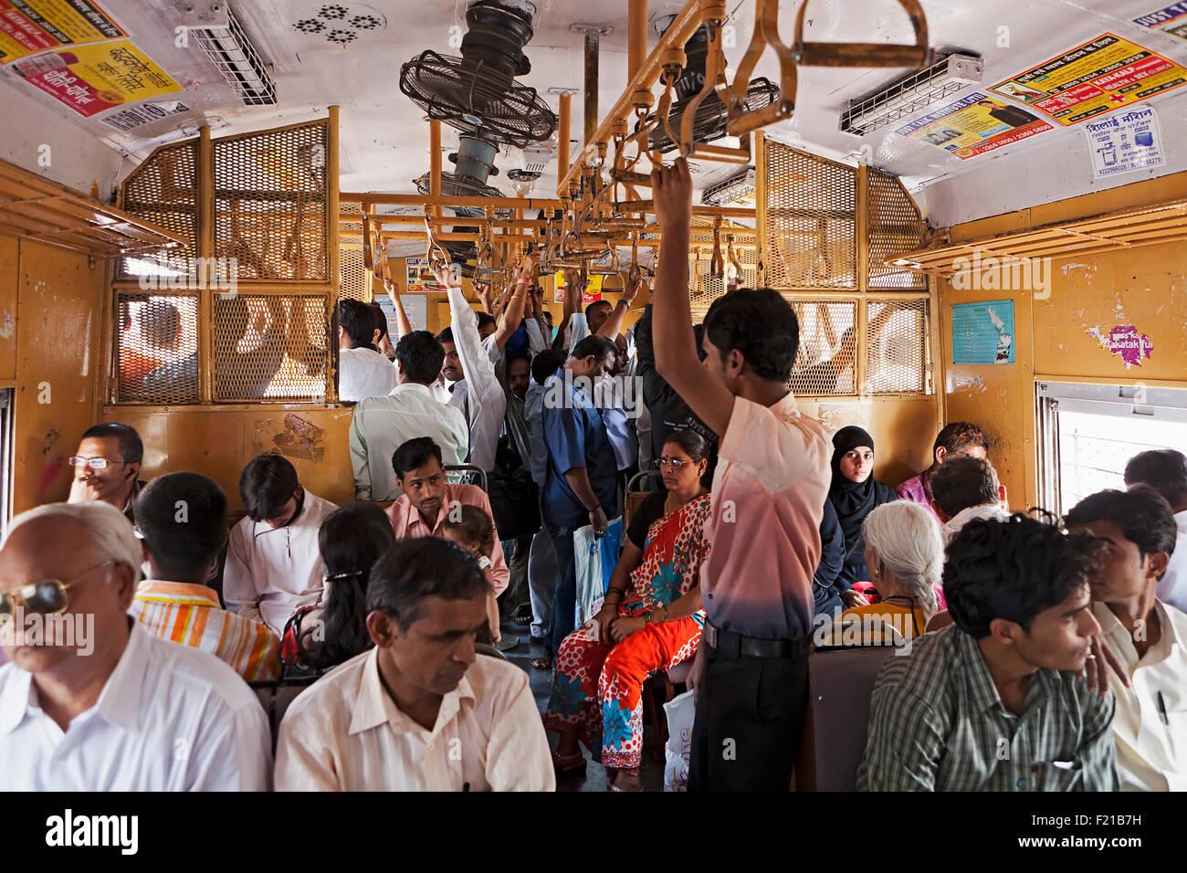India, Maharashtra, Mumbai, Interior of second class carriage of a surburban train. - Stock Image