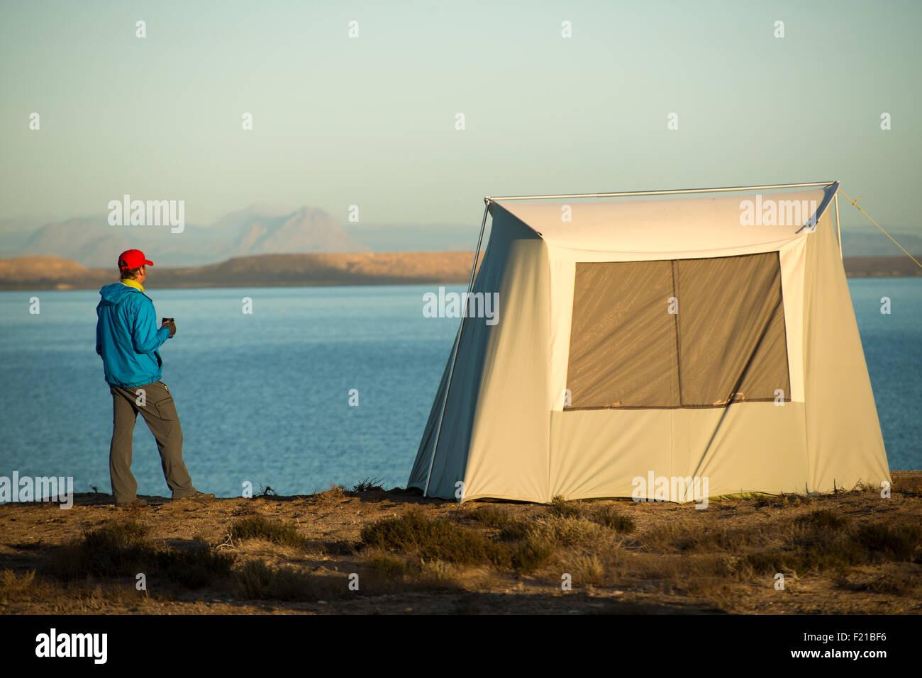 Mexico. San Ignacio Lagoon. Man enjoying morning beverage. - Stock Image