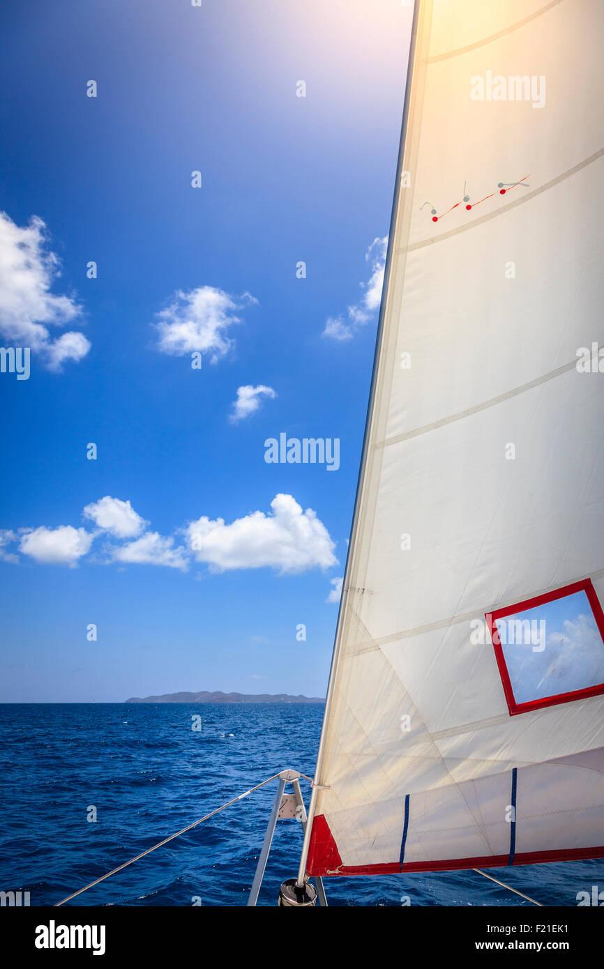 Jib sail in the bow of a sailboat at sea in British Virgin Islands Stock Photo