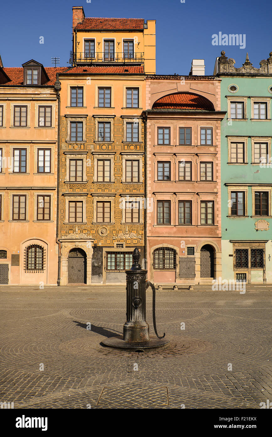 Poland, Warsaw, Stare Miasto or Old Town Square, West side of the square with 19th century iron water pump. - Stock Image