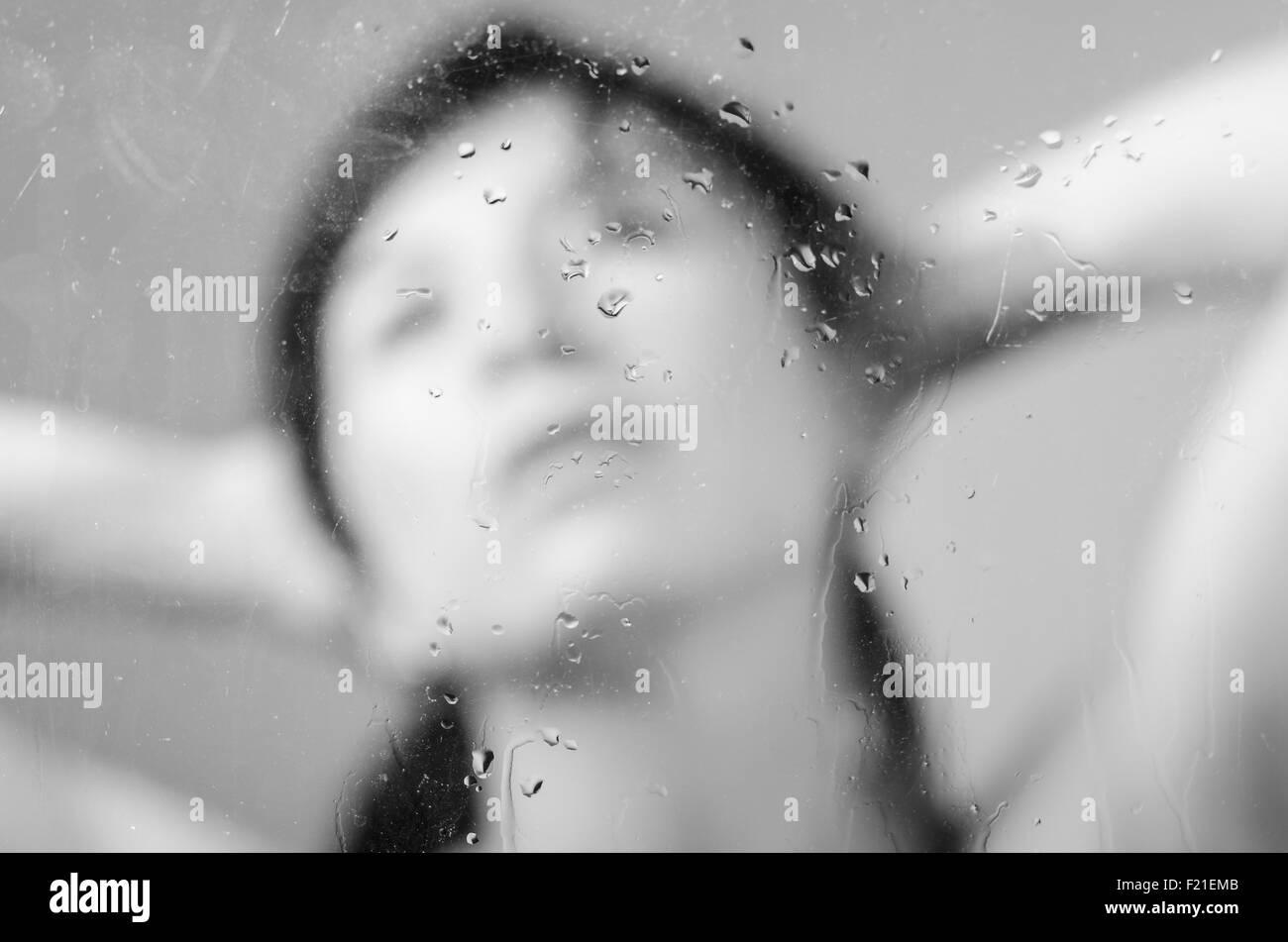 Closeup portrait of brunette girl behind glass Stock Photo