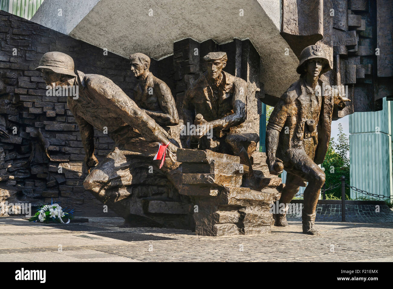 Poland Warsaw Monument to the Warsaw Uprising another section of the monument showing a group of Polish insurgents - Stock Image
