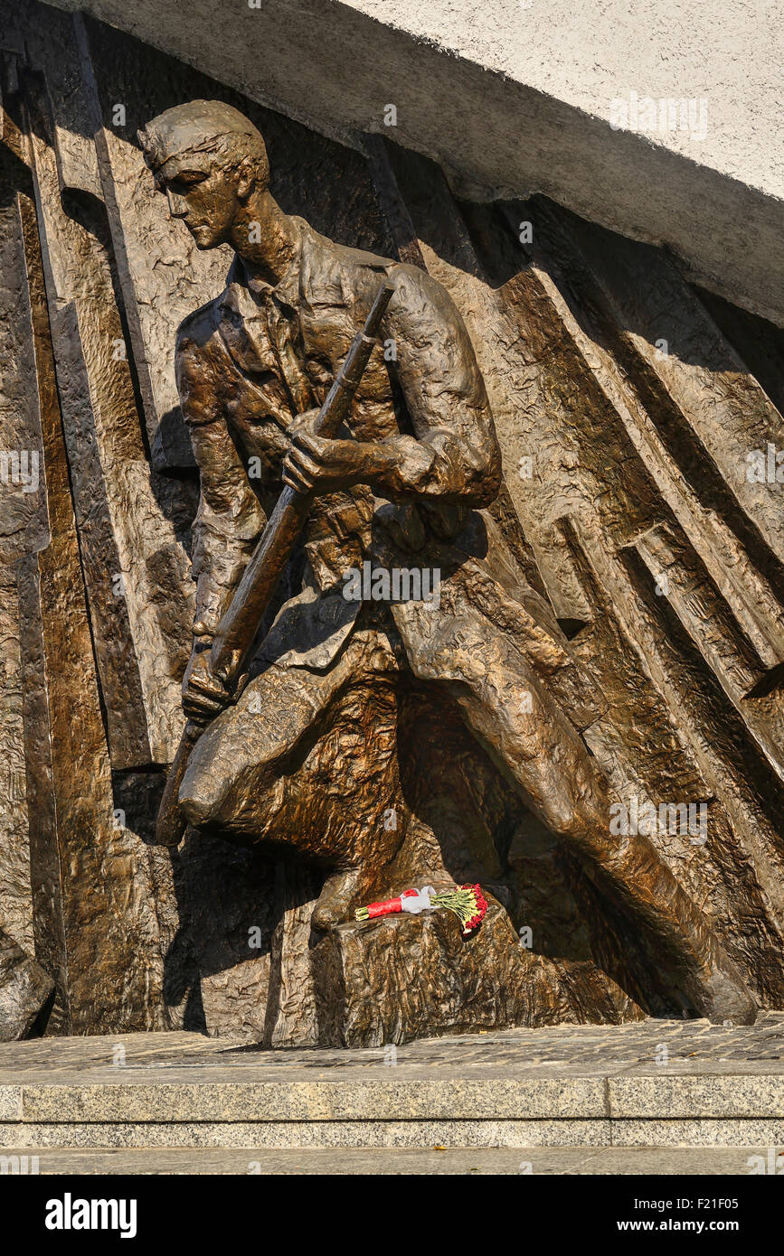 Poland Warsaw Monument to the Warsaw Uprising another section of the monument showing a Polish insurgent actively - Stock Image