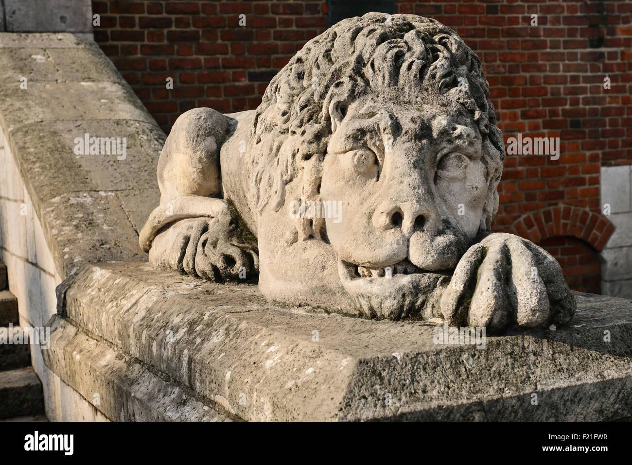 Poland, Krakow, Rynek Glowny or Main Market Square, Wieza Ratuszowa or Town Hall Tower, Stone lion at entrance. - Stock Image