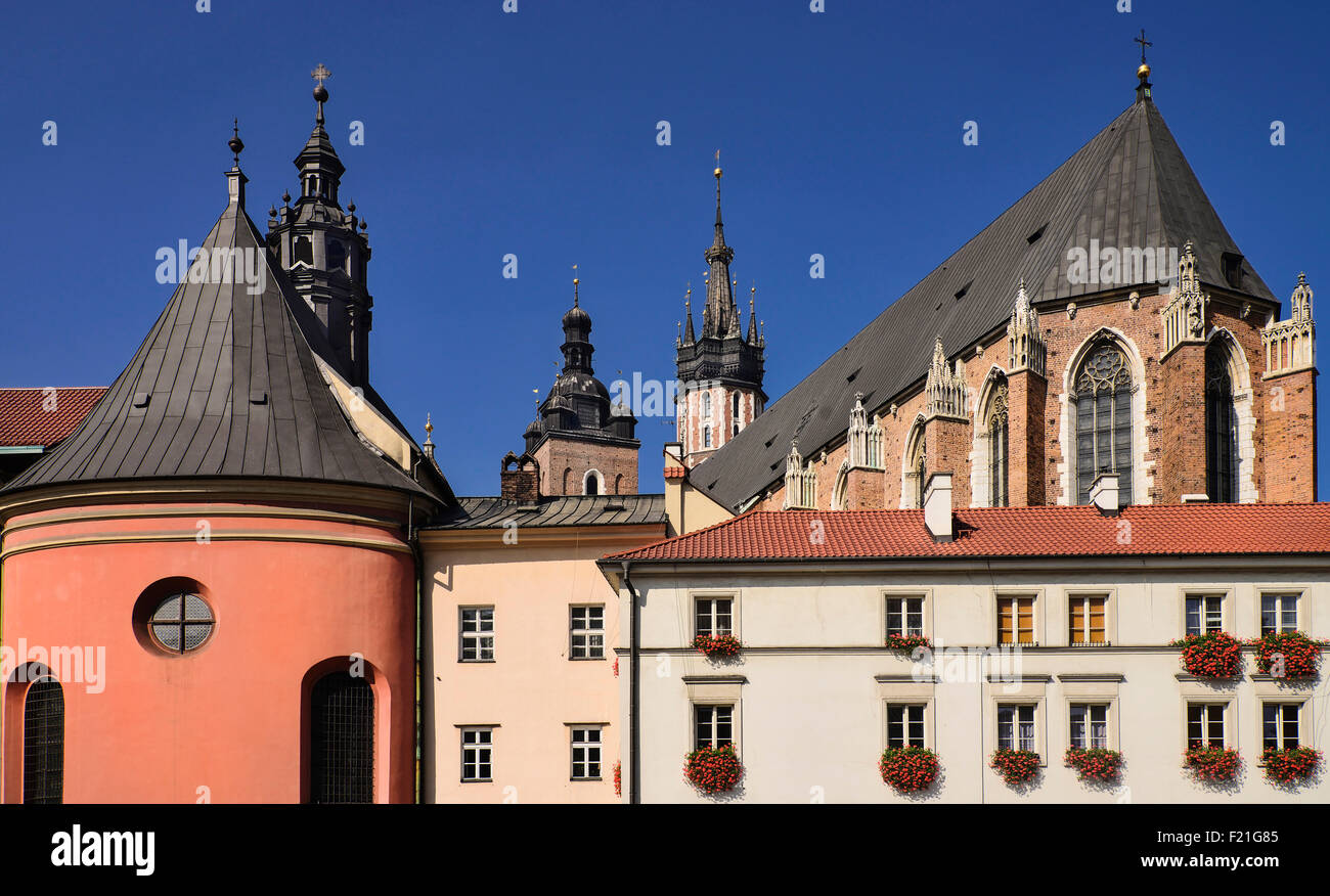 Poland, Krakow, Maly Rynek or Little Market Square, Rear view of Church of Saint Barbara and St Mary's Church. - Stock Image