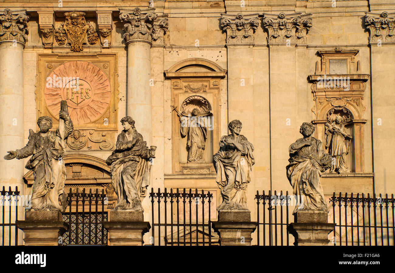 Poland, Krakow, Church of Saints Peter and Paul with statues of the Apostles in the foreground. - Stock Image