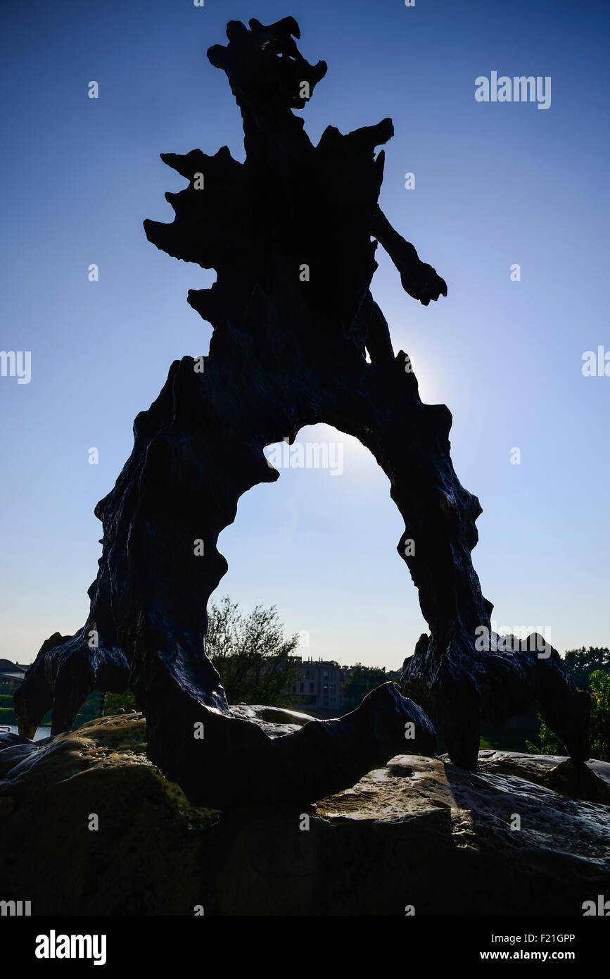 Poland, Krakow, Statue of the Wawel Dragon outside Smocza Jama or the Dragon's Den below Wawel Hill. - Stock Image