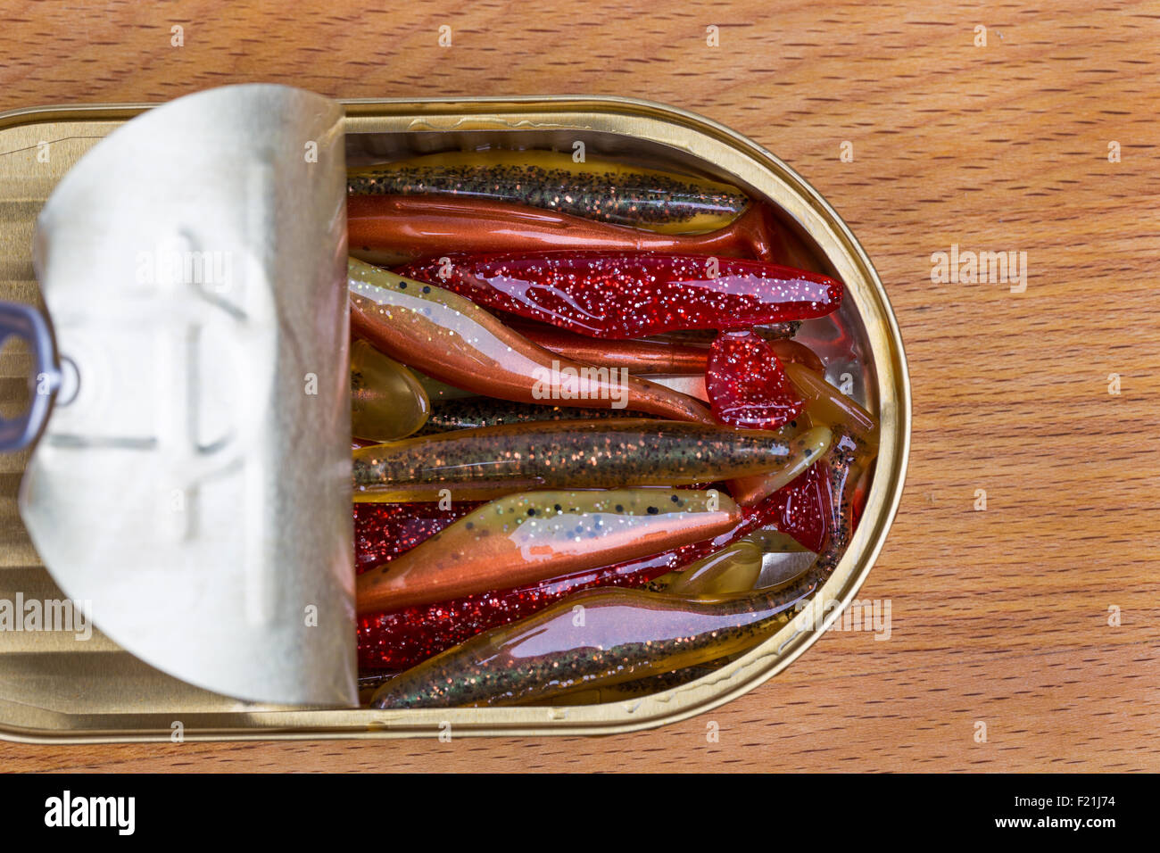 fishing tackles Swimbait different colors in open can on wood Stock ...