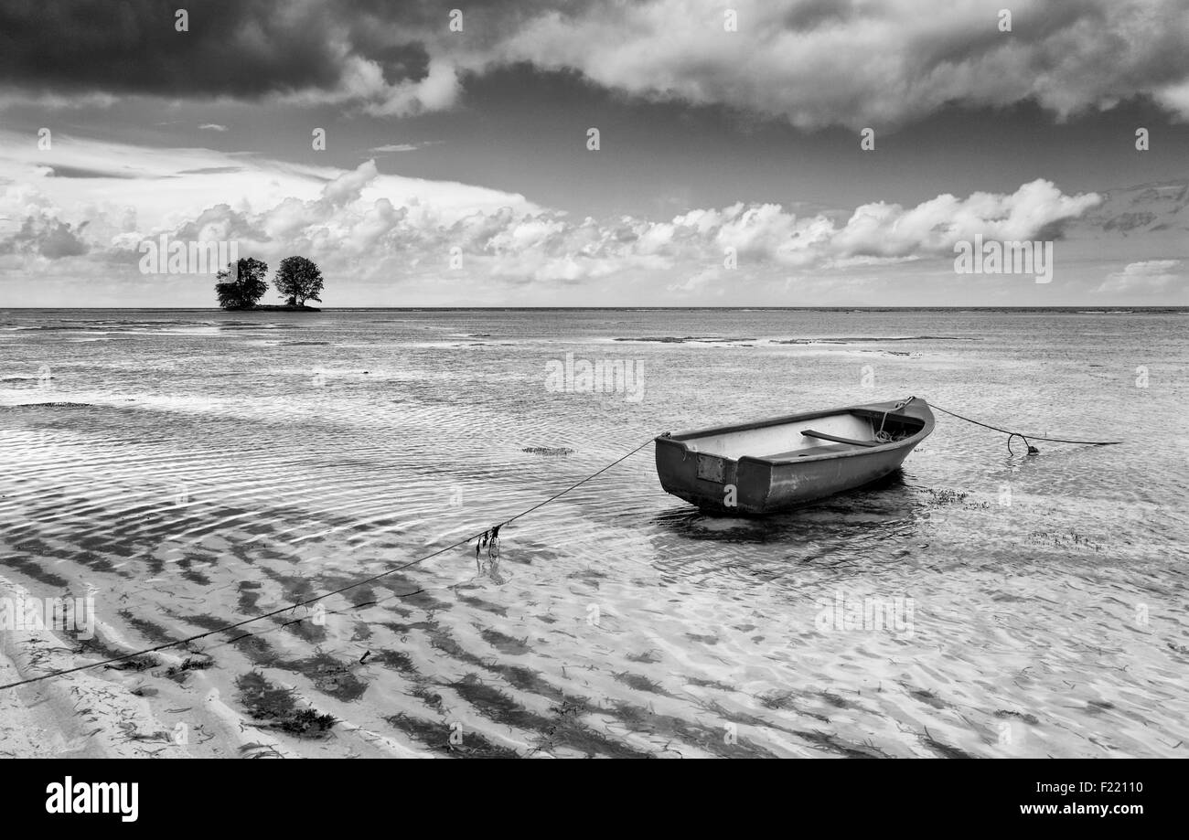 Boat in a lagoon on Seychelles. Black and white photo. - Stock Image