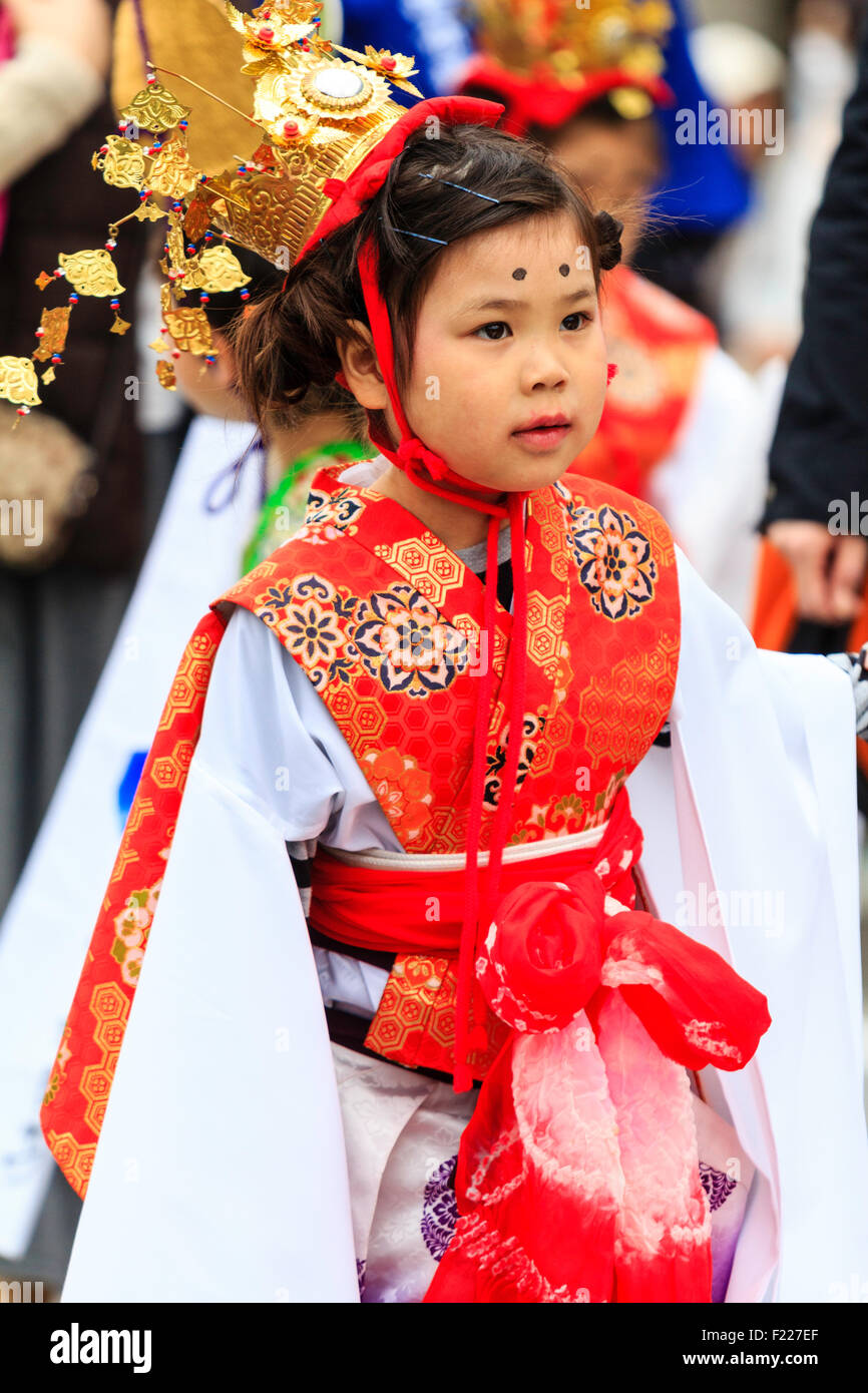 Japan, kawanishi, Osaka. Genji Festival. Little girl, Heian princess costume, walking in parade - Stock Image