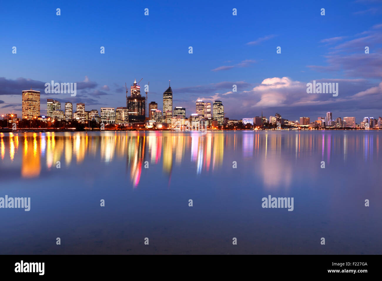 The skyline of Perth, Western Australia at night. Photographed from across the Swan River. - Stock Image